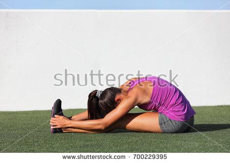 stock-photo-yoga-runner-girl-stretching-back-over-legs-doing-seated-forward-bend-fold-named-paschimottanasana-700229395