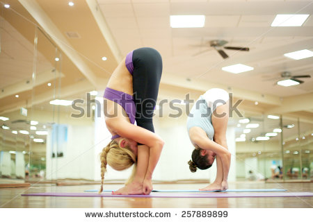 stock-photo-young-women-stretching-their-leg-muscles-touching-their-knees-with-noses-257889899